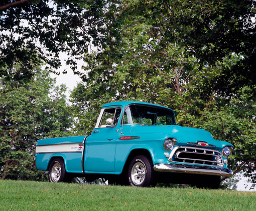 AUT 14 RK0999 01 © Kimball Stock 1957 Chevy Cameo Pick Up Truck Turquoise 3/4 Side View On Grass