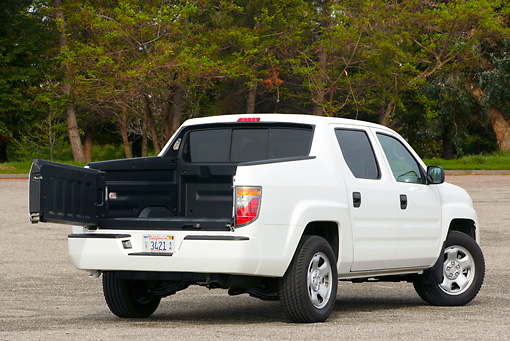 AUT 14 RK1046 01 © Kimball Stock 2006 Honda Ridgeline White Truck 3/4 Rear View Rear Door Open On Pavement