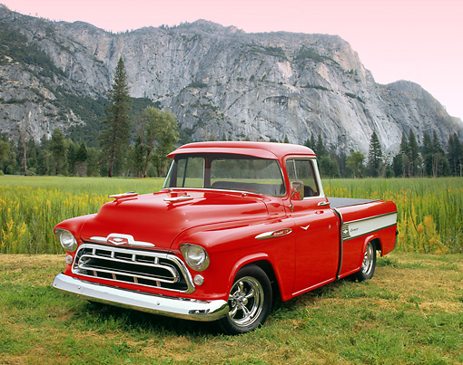 AUT 14 RK1048 02 © Kimball Stock 1957 Chevrolet Cameo Red And White 3/4 Front View On Grass By Mountain