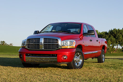 AUT 14 RK1117 01 © Kimball Stock 2006 Dodge, Ram 2500, Laramie Mega Cab, Red Low 3/4 Front View On Grass