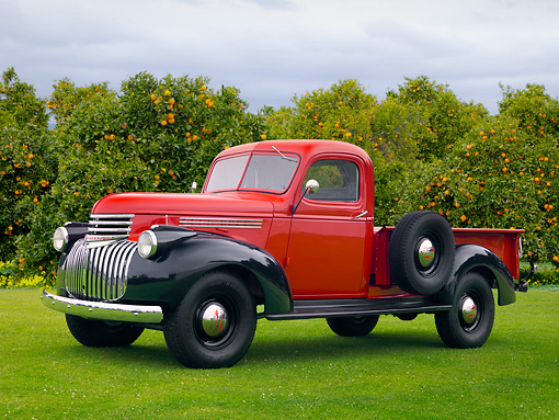 AUT 14 RK1199 01 © Kimball Stock 1941 Chevrolet 3/4 Ton Red And Black 3/4 Side View On Grass By Orange Trees