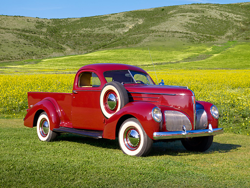 AUT 14 RK1224 01 © Kimball Stock 1939 Studebaker Coupe Express Cabernet 3/4 Front View On Grass By Wildflowers And Hills
