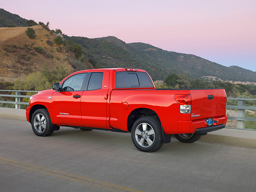 AUT 14 RK1244 01 © Kimball Stock 2007 Toyota Tundra Double Cab SR5 Red 3/4 Rear View On Pavement By Hills At Dusk