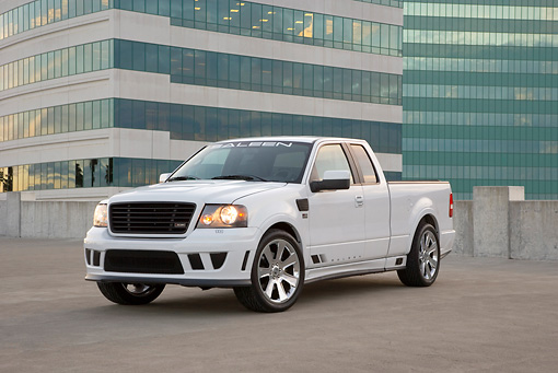 AUT 14 RK1297 01 © Kimball Stock 2007 Saleen S331 Supercharged Sport Truck White Low 3/4 Front View On Pavement By Building