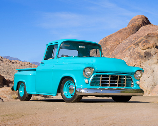 AUT 14 RK1383 01 © Kimball Stock 1956 Chevrolet Stepside Pickup Truck Turquoise 3/4 Front View On Dirt By Rocks