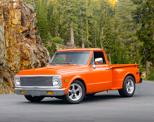 AUT 14 RK1384 01 © Kimball Stock 1972 GMC 1/2 Ton Pickup Truck Orange 3/4 Front View On Pavement In Forest