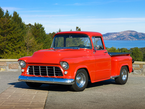 AUT 14 RK1401 01 © Kimball Stock 1957 Chevrolet Stepside Pickup Truck Red 3/4 Front View On Pavement By Water And Trees