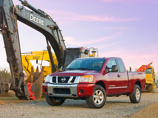 AUT 14 RK1424 01 © Kimball Stock 2009 Nissan Titan 4x4 SE Pickup Truck Red 3/4 Front View On Dirt By Construction Equipment