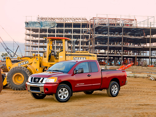 AUT 14 RK1427 01 © Kimball Stock 2009 Nissan Titan 4x4 SE Pickup Truck Red 3/4 Front View On Dirt By Construction Equipment