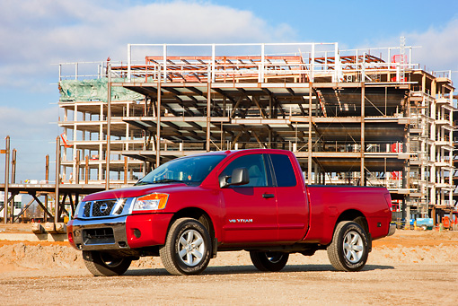AUT 14 RK1431 01 © Kimball Stock 2009 Nissan Titan 4x4 SE Pickup Truck Red 3/4 Front View On Dirt By Construction
