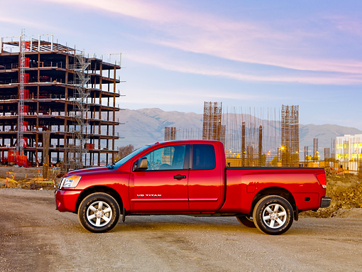 AUT 14 RK1436 01 © Kimball Stock 2009 Nissan Titan 4x4 SE Pickup Truck Red Profile View On Dirt By Construction