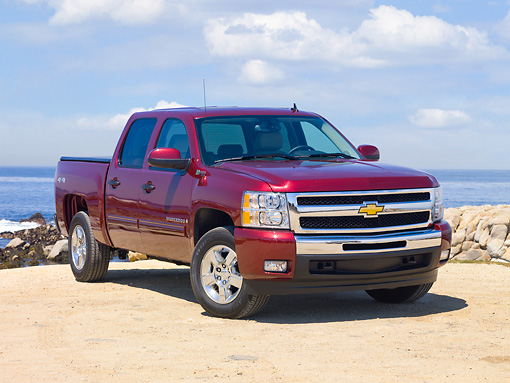 AUT 14 RK1484 01 © Kimball Stock 2010 Chevrolet Silverado Hybrid Red 3/4 Front View By Ocean