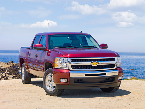 AUT 14 RK1485 01 © Kimball Stock 2010 Chevrolet Silverado Hybrid Red 3/4 Front View By Ocean
