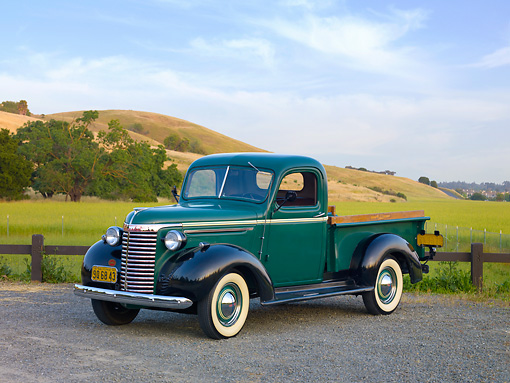 AUT 14 RK1529 01 © Kimball Stock 1940 Chevrolet Pickup Truck Green 3/4 Front View On Gravel By Hills