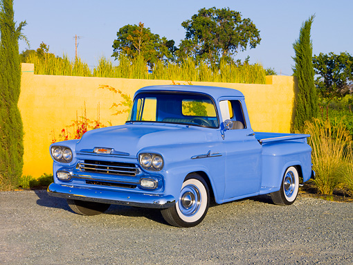 AUT 14 RK1540 01 © Kimball Stock 1958 Chevrolet Apache Pickup Truck Blue 3/4 Front View On Gravel By Wall
