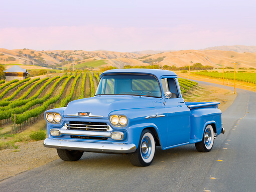 AUT 14 RK1542 01 © Kimball Stock 1958 Chevrolet Apache Pickup Truck Blue 3/4 Front View On Pavement By Vineyard