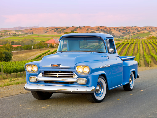 AUT 14 RK1545 01 © Kimball Stock 1958 Chevrolet Apache Pickup Truck Blue 3/4 Front View On Pavement By Vineyard