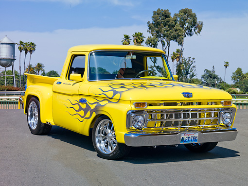 AUT 14 RK1546 01 © Kimball Stock 1965 Ford F-100 Stepside Pickup Truck Yellow 3/4 Front View On Pavement