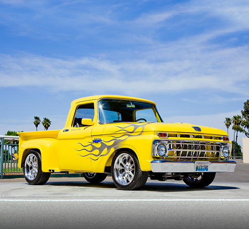 AUT 14 RK1548 01 © Kimball Stock 1965 Ford F-100 Stepside Pickup Truck Yellow 3/4 Front View On Pavement