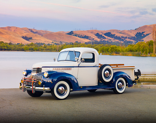 AUT 14 RK1550 01 © Kimball Stock 1946 Chevrolet 1/2 Ton Pickup Truck White And Blue 3/4 Front View On Pavement By Lake