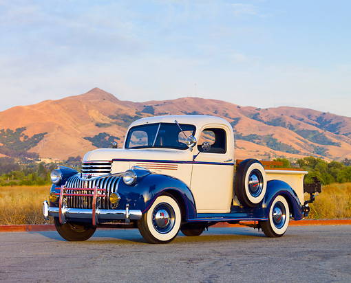 AUT 14 RK1551 01 © Kimball Stock 1946 Chevrolet 1/2 Ton Pickup Truck White And Blue 3/4 Front View On Pavement By Hills