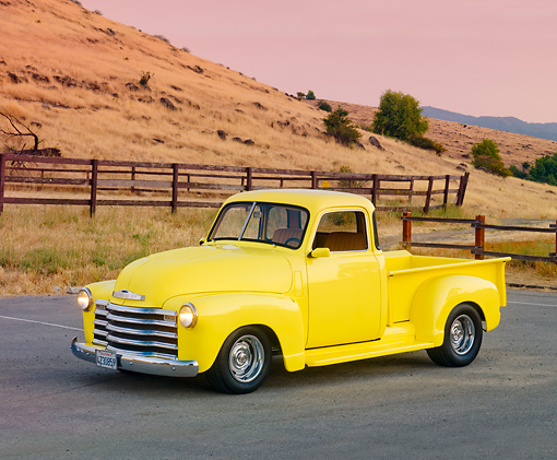 AUT 14 RK1558 01 © Kimball Stock 1950 Chevrolet Pickup Truck Yellow 3/4 Front View On Pavement By Hills