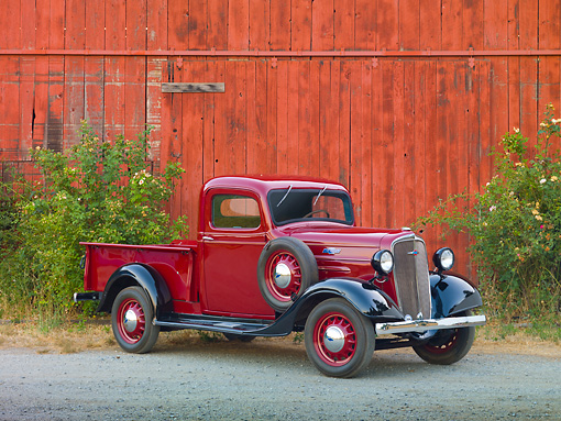 AUT 14 RK1572 01 © Kimball Stock 1936 Chevrolet Pickup Truck Red 3/4 Front View On Gravel By Barn