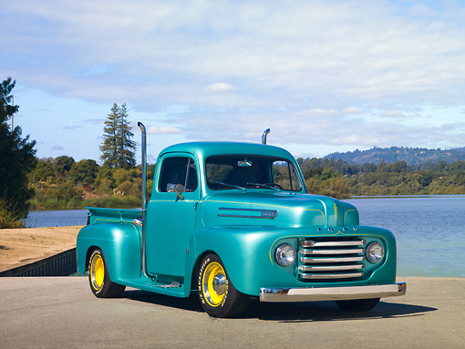AUT 14 RK1579 01 © Kimball Stock 1950 Ford F1 Pickup Truck Green 3/4 Front View On Pavement By Lake