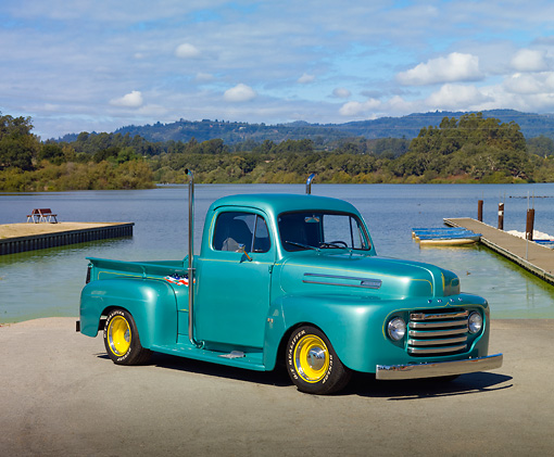AUT 14 RK1580 01 © Kimball Stock 1950 Ford F1 Pickup Truck Green 3/4 Front View On Pavement By Lake