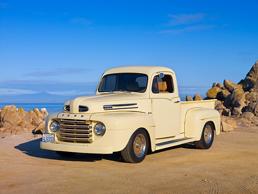 AUT 14 RK1583 01 © Kimball Stock 1949 Ford F-1 Pickup Truck Light Yellow On Sand By Ocean