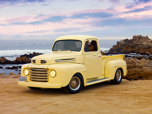 AUT 14 RK1587 01 © Kimball Stock 1949 Ford F-1 Pickup Truck Light Yellow On Sand By Ocean