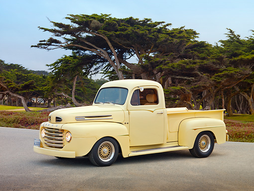 AUT 14 RK1589 01 © Kimball Stock 1949 Ford F-1 Pickup Truck Light Yellow On Pavement By Trees