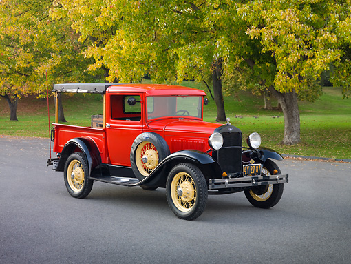 AUT 14 RK1591 01 © Kimball Stock 1931 Ford Closed Cab Budd Body Pickup Truck Red On Pavement By Trees