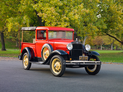 AUT 14 RK1593 01 © Kimball Stock 1931 Ford Closed Cab Budd Body Pickup Truck Red On Pavement By Trees
