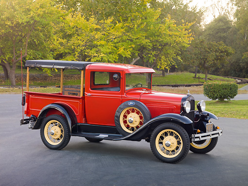 AUT 14 RK1596 01 © Kimball Stock 1931 Ford Closed Cab Budd Body Pickup Truck Red On Pavement By Trees