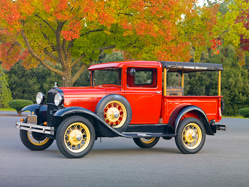 AUT 14 RK1597 01 © Kimball Stock 1931 Ford Model A Closed Cab Budd Body Pickup Truck Red On Pavement By Trees