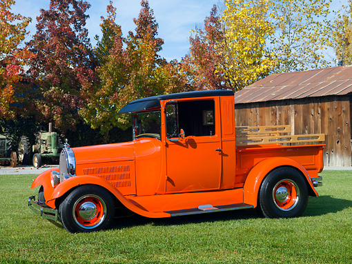 AUT 14 RK1599 01 © Kimball Stock 1928 Ford Model A Pickup Truck Orange 3/4 Front View On Grass By Barn