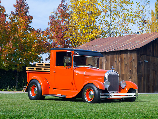 AUT 14 RK1600 01 © Kimball Stock 1928 Ford Model A Pickup Truck Orange 3/4 Front View On Grass By Barn