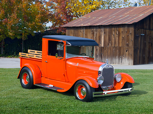 AUT 14 RK1601 01 © Kimball Stock 1928 Ford Model A Pickup Truck Orange 3/4 Front View On Grass By Barn