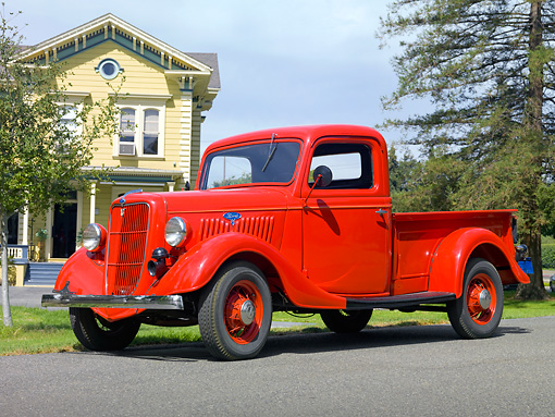 AUT 14 RK1609 01 © Kimball Stock 1935 Ford Pickup Truck Red 3/4 Front View On Pavement By House