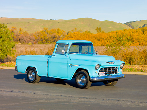 AUT 14 RK1610 01 © Kimball Stock 1955 Chevy Cameo Pickup Blue 3/4 Front View By Hills and Trees.