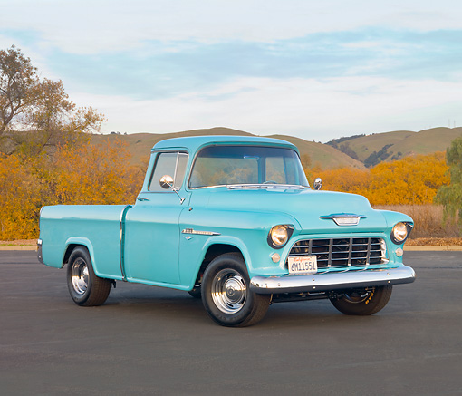AUT 14 RK1611 01 © Kimball Stock 1955 Chevy Cameo Pickup Blue 3/4 Front View By Hills and Trees.
