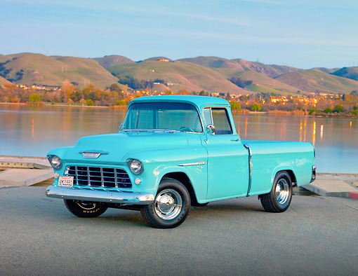 AUT 14 RK1612 01 © Kimball Stock 1955 Chevy Cameo Pickup Blue 3/4 Front View By Hills and Trees.