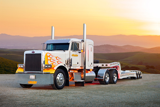 AUT 14 RK1615 01 © Kimball Stock 1991 Peterbilt Semi White With Orange And Yellow Flames 3/4 Front View On Pavement By Sunset