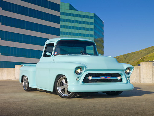 AUT 14 RK1618 01 © Kimball Stock 1957 Chevrolet Pickup Truck Pastel Aqua 3/4 Front View On Pavement By Building