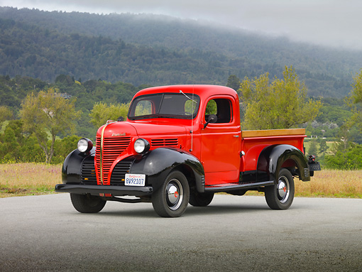 AUT 14 RK1619 01 © Kimball Stock 1939 Plymouth PT-81 Pickup Truck Red And Black 3/4 Front View On Pavement By Trees And Fog
