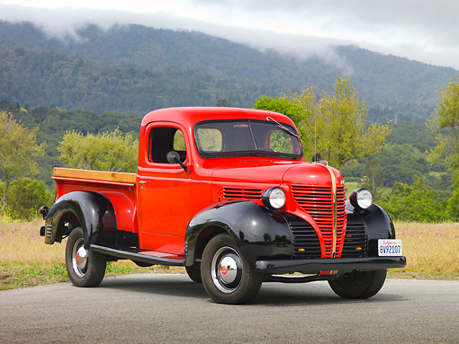 AUT 14 RK1620 01 © Kimball Stock 1939 Plymouth PT-81 Pickup Truck Red And Black 3/4 Front View On Pavement By Trees And Fog