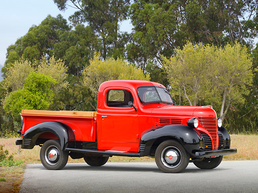 AUT 14 RK1623 01 © Kimball Stock 1939 Plymouth PT-81 Pickup Truck Red And Black 3/4 Side View On Pavement By Trees And Fog