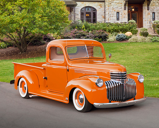 AUT 14 RK1636 01 © Kimball Stock 1941 Chevrolet Pickup Truck Orange 3/4 Front View On Pavement By House