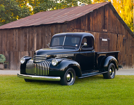 AUT 14 RK1638 01 © Kimball Stock 1946 Chevrolet Pickup Truck Black 3/4 Front View On Grass By Shed